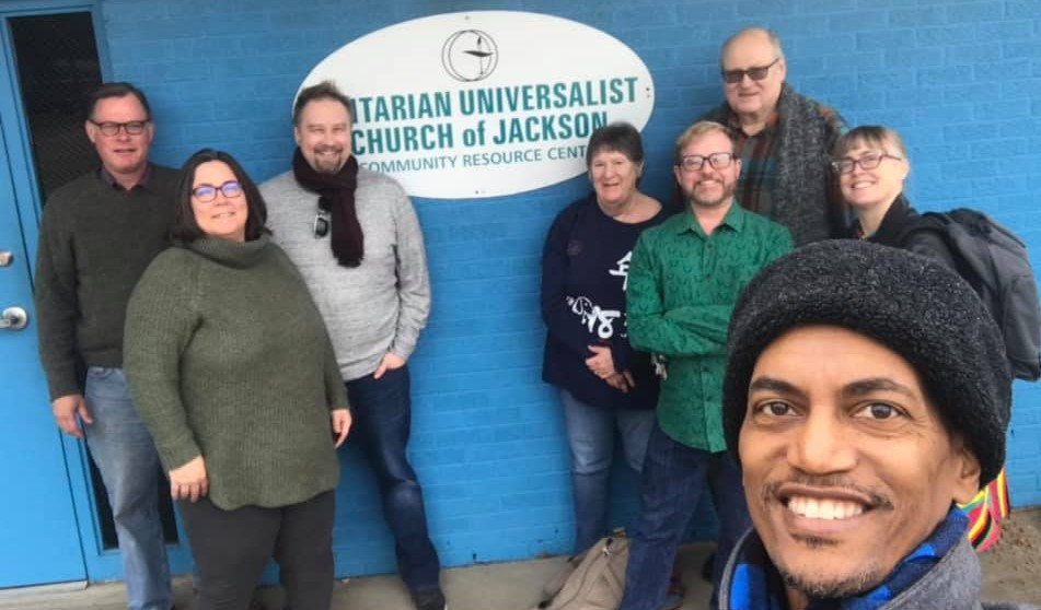 UUCJ Members and Southern Region staff in front of the UUCJ West Street building sign