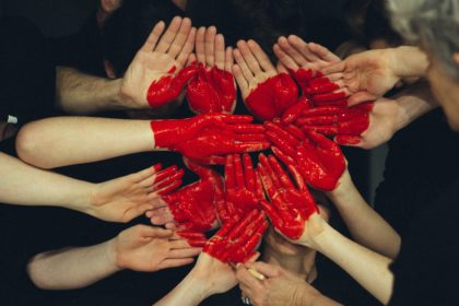 group of hands forming a heart